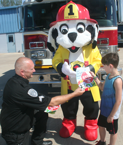 Firepup® Mascot with Firefighter Spotter and kid